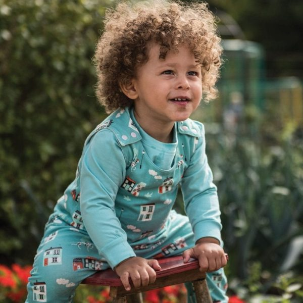 Toddler wearing house print dungarees from Cotton Boulevard