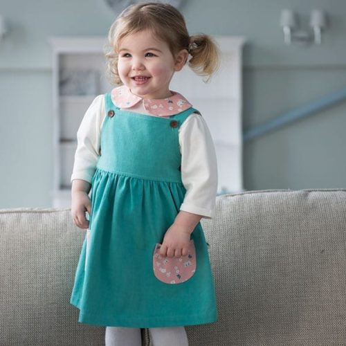 Girl in Dark Green Twill Butterfly Pocket Pinafore