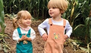 toddler and young child in corn field